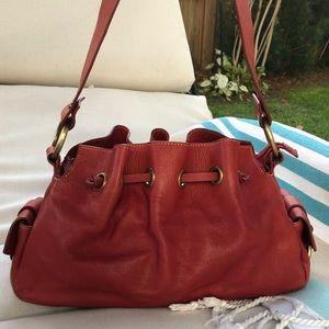 Aqua Madonna red leather drawstring bag good cond.